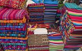 Colorful stack of Mexican shirts