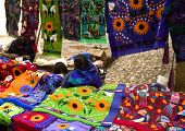 Mayan people selling shirts