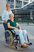 Disabled Senior Woman With Extended Care