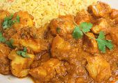 Indian chicken dansak with Bombay aloo potato curry and pilau rice.