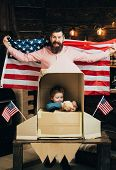 American Cheerful Family With Usa Flags Play With Rocket Made Out Of Cardboard Box. Kid Happy Sit In poster