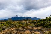 Dramatic Landscape Of Patagonian Mountains, Taken From The Beagle Channel On A Dramatic, Cloudy Day. poster