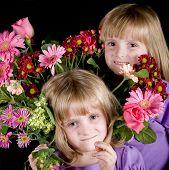 Twin Girls In Bouquet Of Flowers
