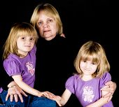 Twin Girls In Quiet Moment With Grandmother