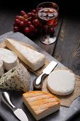 French Cheeses Plate In Assortment, Blue Cheese, Brie, Munster, Soft Goat Cheese poster