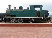 An Old Green Classic Steam Train , The First Steam Train First Operated In 1804 poster