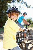 stock photo of little boy  - Little boy on country bike ride with dad - JPG