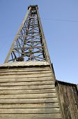 Old fashioned wooden oil derrick
