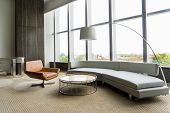 Modern Lounge Room Interior In Office Building. Room With Panoramic Window, Modern Leather Chair, Wh poster