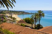 View Of Coastline Of Costa Dorada In Miami Platja, Sea, Beach, Palms And Tiled Roofs Of Houses With  poster