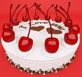 Valentines Day: Tasty Cake With Cherries On Red