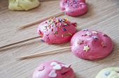 Pink Kiss French Dessert Meringues. Pink Dreams. Sweet Life Concept With Candy On Sticks. Showcase A poster