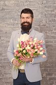 Romantic Man With Flowers. Romantic Gift. Macho Getting Ready Romantic Date. Waiting For Darling. Tu poster