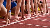 pic of sprinter  - athletes in a sprint start in track and field - JPG
