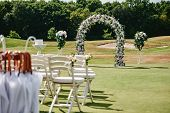 Place For Wedding Ceremony On Green Golf Course, Copy Space. Wedding Arch Decorated With Flowers And poster