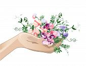 Hand And Sweet Pea Flowers