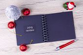 2019. Review. The Concept Of The Analysis Of The Past Year. Notepad With Festive Decor On A Wooden T poster