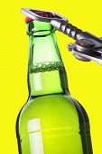 Opening Beer Bottle With Metal Opener