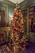 Classic Christmas New Year Decorated Interior Room Fireplace New Year Tree. Christmas Tree With Silv poster