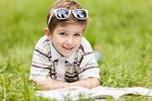 Beauty Smiling Child Boy Reading Book Outdoor