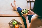 Woman Hands Holding And Eating Healthy Salad For Breakfast In The Morning poster