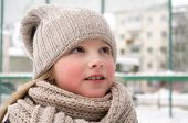 Knitwear. Child Smiling With Long Blond Hair Outdoor, Beauty. Small Girl Smile In Gray Knitted Hat A poster