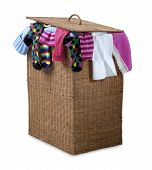 Overflowing Wicker Laundry Basket Isolated With Clipping Path