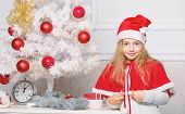 Cherished Holiday Activity. Kid In Santa Hat Decorating Christmas Tree. Family Tradition Concept. Ch poster