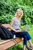 Modern Student Life. Surfing Internet. Girl Adorable Student With Laptop Coffee Cup And Backpack Sit poster