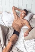 Young Handsome Man Rest In Bed. Sexy Naked Guy Is Resting poster