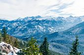 Surreal Fantastic Mountain Landscape, Turquoise Blue Mountains And Snow-covered Christmas Trees poster