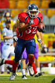 VIENNA, AUSTRIA - MAY 8 RB Jerson Wolfe DeVonne (#32 Calanda Broncos) runs with the ball on May 8, 2
