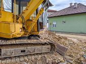 Excavator Machine Clearing Up Space For Building And Renovating New House In Neighborhood. Heavy Mac poster