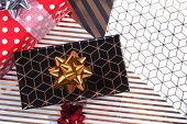 Three Gift Boxes Red In White Polka Dots And Black With Gold, Red And Gold Serpentine, Red Bow On Wr poster
