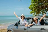 Summer Vacation And Car Trip Concept : Family Car Trip At The Sea, Woman And Child Cheerful Raising  poster