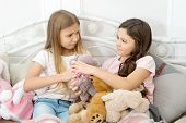 Generosity And Greediness. Teach Sister Sharing Toys. Greedy Sisters. Kids Play Toys In Bed. Little  poster