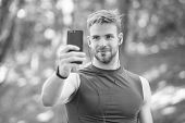 Sport App On Phone. Digital Sport. Smart Watch. Athletic Man In Sportswear Make Selfie. Outdoor Work poster