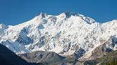 stock photo of karakoram  - Nanga Parbat is the ninth highest mountain in the world and western anchor of the Himalayas - JPG