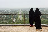 stock photo of burka  - Muslim Women with Burqa in Islamabad Pakistan - JPG