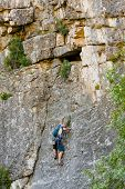 Man Practices In Climbing At The Rock In The Crimea Mountains