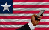 Cell Phone In Front  National Flag Of Liberia
