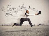 foto of competing  - Concept of fast business with running businessman - JPG