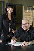 Tattooer Preparing Tattoo For Happy Client