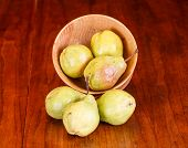 Three Pears Each On Table And In Bowl