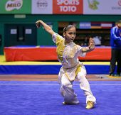 KUALA LUMPUR - NOV 03: Ilayda Emen of Turkey shows her fighting style in the 'changquan compulsory'