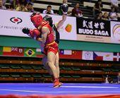 KUALA LUMPUR - NOV 03: Malaysia's Tan Jia Guan in red tries to take down Sweden's Johan Lindqvist in