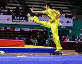 KUALA LUMPUR - NOV 03: Yeap Wai Kin of Malaysia shows a wushu high kick in the 'changquan compulsory