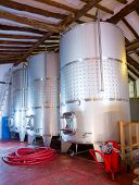Stainless steel fermentation tanks vessels indoor of mediterranean winery