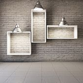 Brick wall with empty shelves and lamps