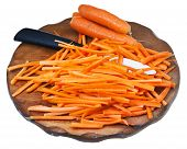 Raw Cut Carrot And Ceramic Knife On Cutting Board